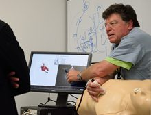 Dr. Ed McGough demonstrating a simulator